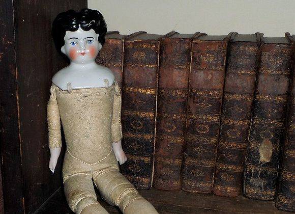 Circa 1900 'Low Brow' German China Head Doll with Leather Body