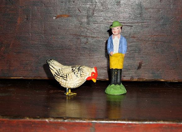 Antique German Farmer and Feeding Hen