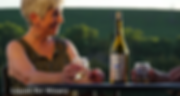 Woman enjoying bottle of Chardonnay at Liquid Art Winery in Manhattan, KS