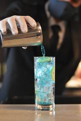 La Trattoria Bartender pouring a cocktail