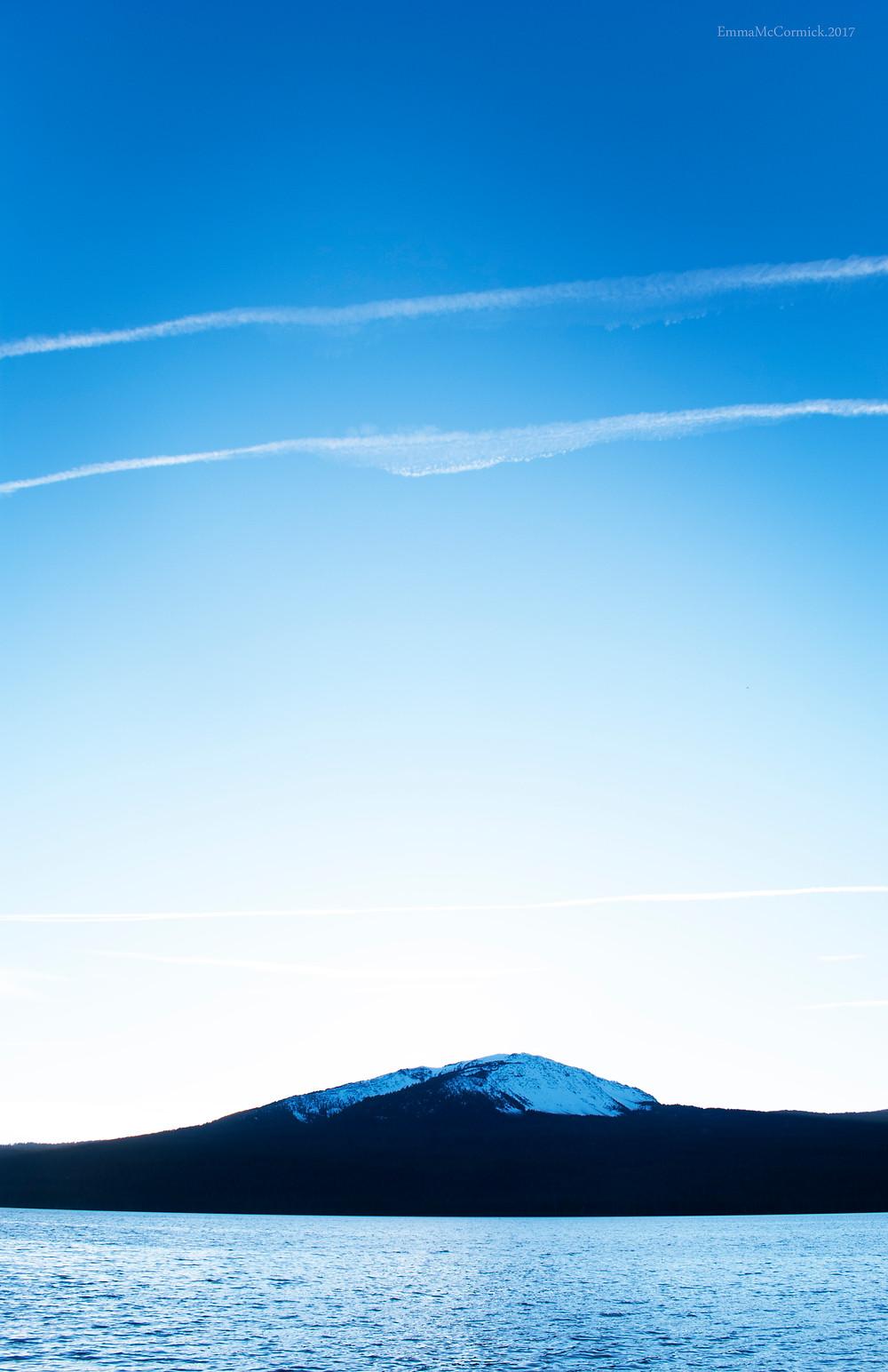 Blue evening sky, Lake and snow capped mountain. Diamond Lake.