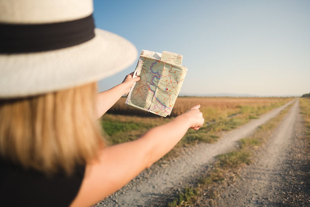 woman with map in road trip, hiking in n