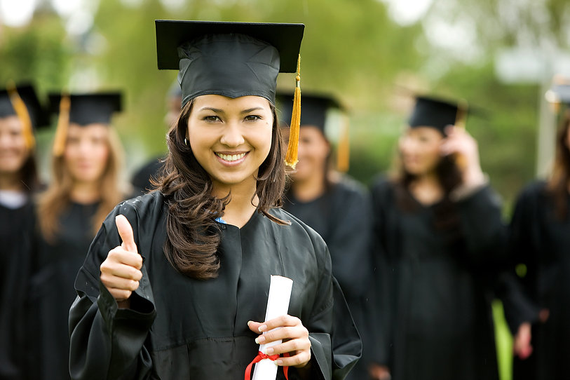 graduation girl holding her diploma with pride.jpg