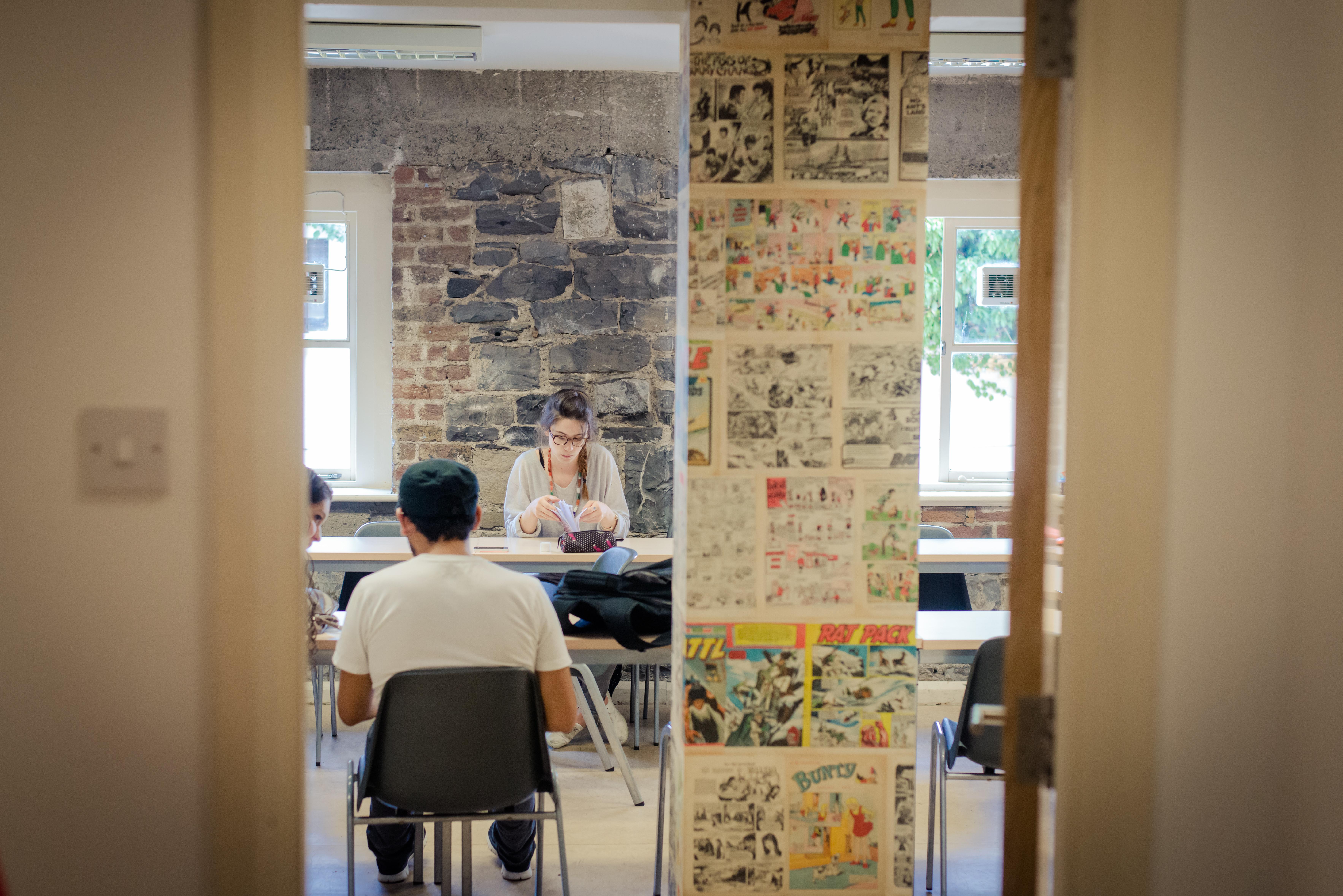 MB_2_students through classroom door