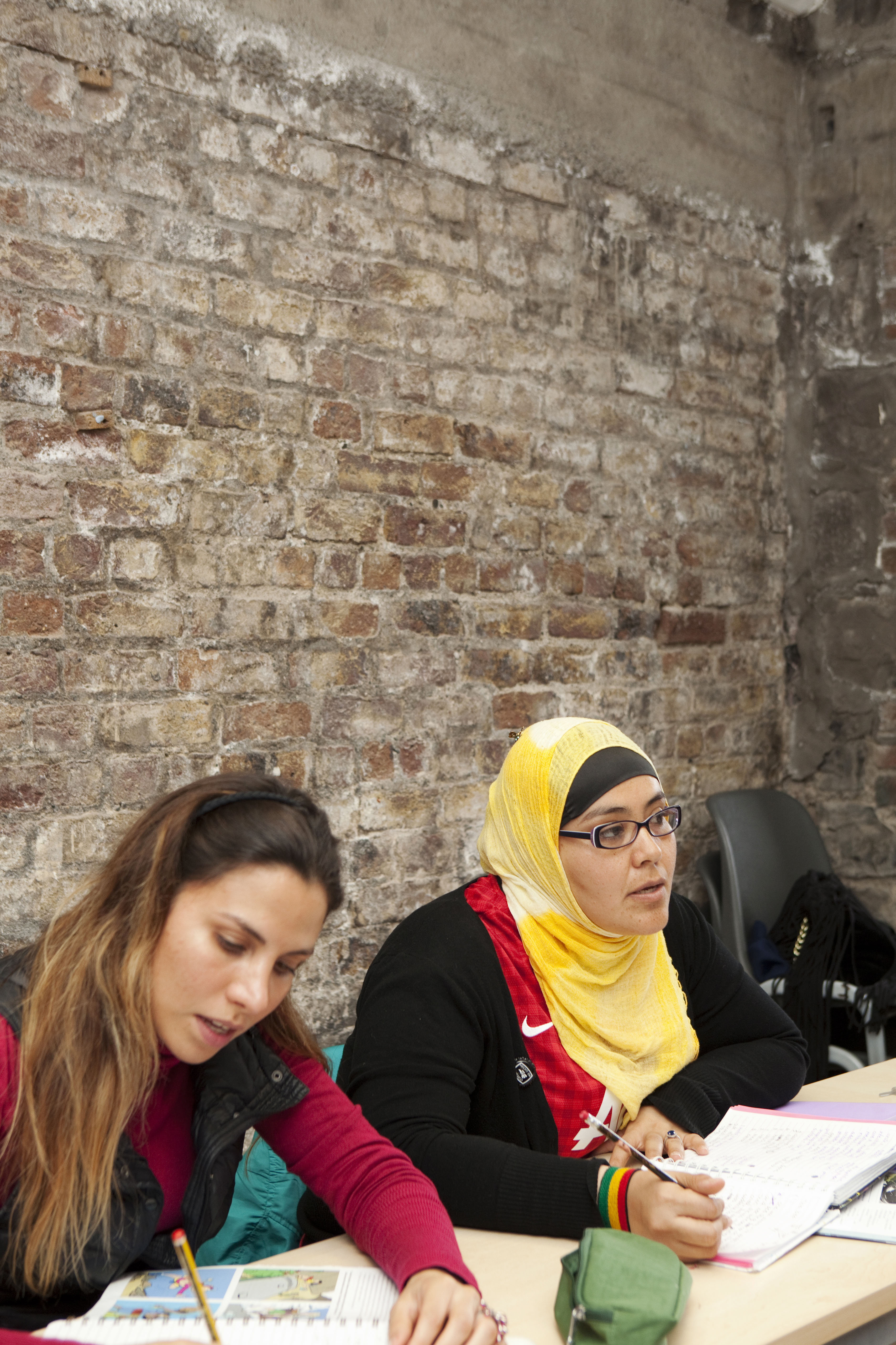 ISI Dublin English Languge School, two students in class, redbrick wall
