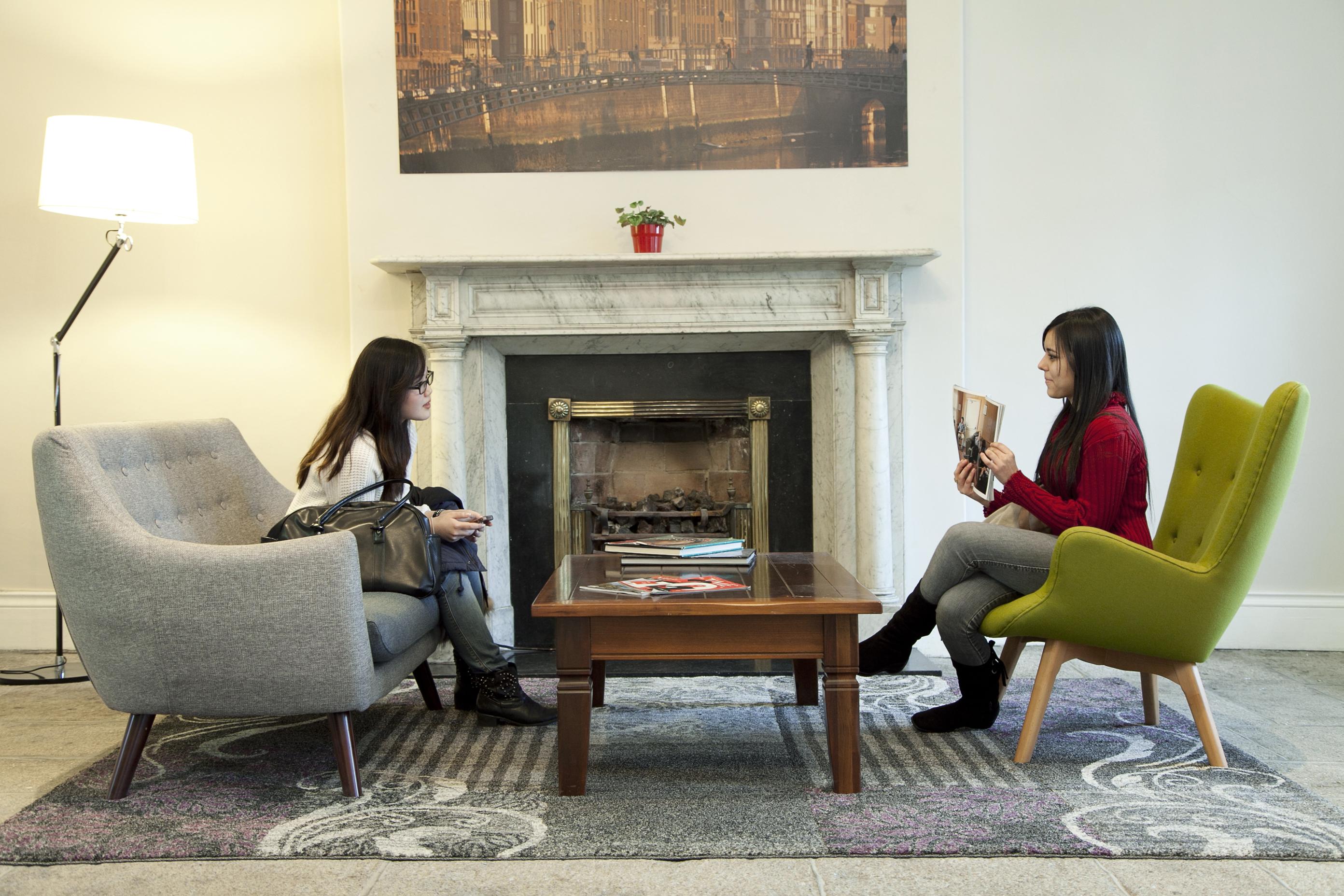 two girls reading magazines