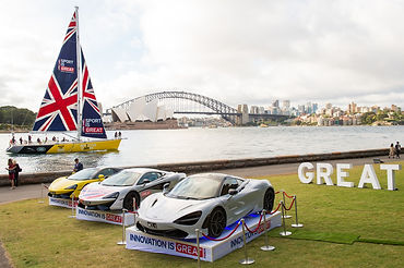 Sport is GREAT' and 'Innovation is GREAT' branded yacht and cars in front of the Sydney Opera House