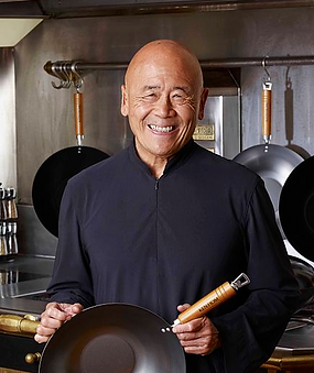 Chef Ken Hom posing in a kitchen
