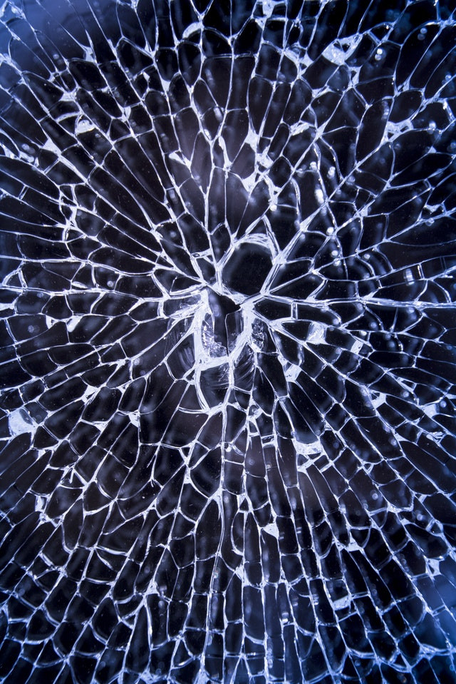 A shattered surface, representing the shattering of the first crystal.