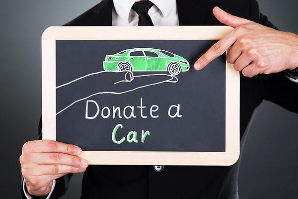 Close-up Of Businessman Showing Car Dona