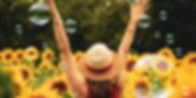 happy-woman-in-sunflower-field-1170x585.