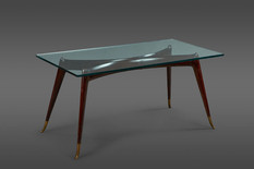 AN EXQUISITELY SCULPTURAL ROSEWOOD COFFEE TABLE WITH BRASS SABOTS