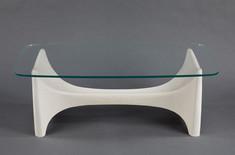 A SCULPTURAL FIBERGLASS TABLE BASE WITH CUSTOM GLASS TOP