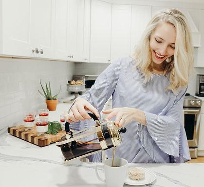 Dina pouring coffee