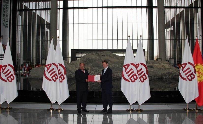 Vice President Sir Danny Alexander presenting the Certificate of Membership of the AIIB to His Excellency Ambassador 'Uta'atu