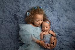 siblings baby photos in bedford