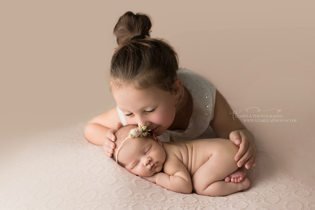 newborn baby with sister photo