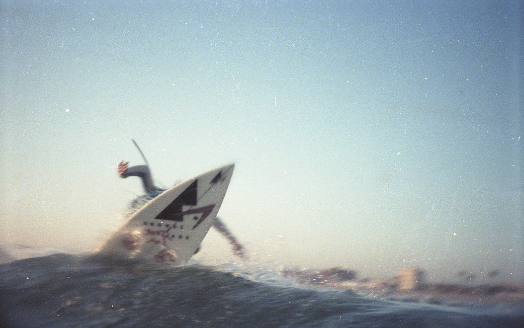 """Ricky """"Rickle"""" Massie surfing the North Side of the Venice Break Water. I took this with my short lived second hand water camera. Venice, CA. 1980'z"""