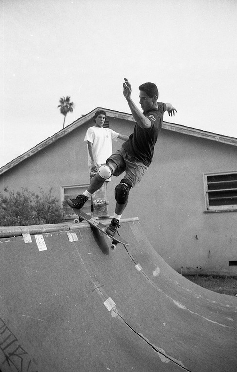 "Jesse ""The Mess"" Martinez skating Ricky Massies mini half pipe. Brian Zarate Dahlheimer (RIP) in the background. Venice, CA. 1980'z"