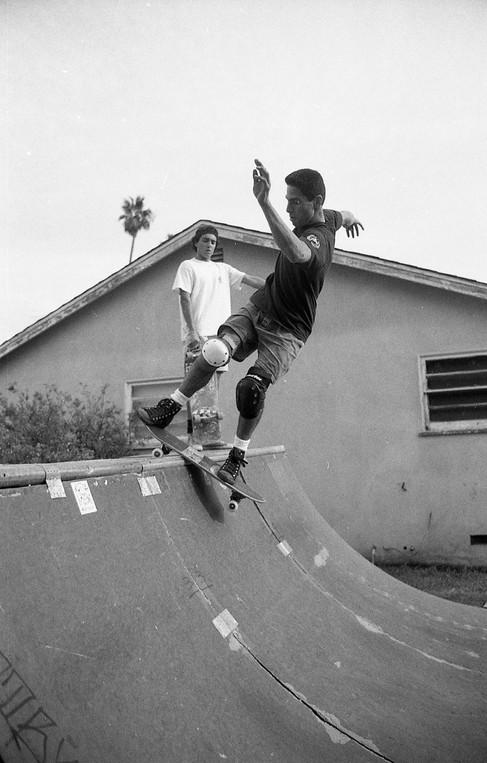 "Jesse ""The Mess"" Martinez skating Ricky Massies mini half pipe. Brian Zarate Dahlheimer (RIP) in the background. Venice, CA. 1980'z"