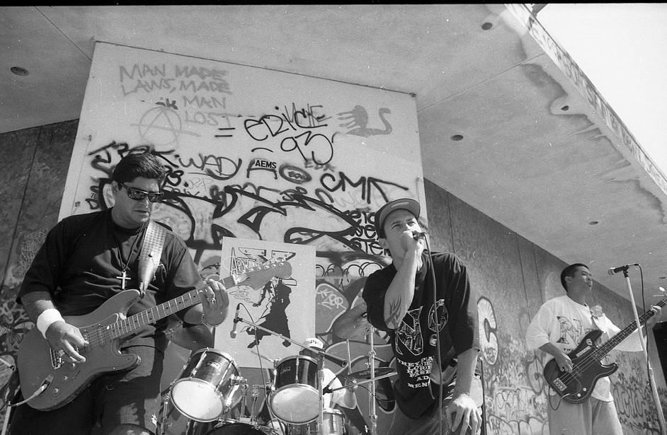 Local punk rock band Nonoxynol 9 (N9) playing at the Venice Pavilion. Venice, CA. 1993