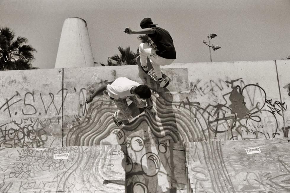 "Joey Vo-Tran and Eric ""Lil Man"" Garber skating the Venice Pavilion. Venice CA, 1980'z"