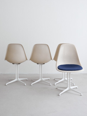 """Eames la fonda Designed early 1960s for the """"la fonda resturant"""" in the Time Life building in NYC. Off white fibreglass shell and a upholstery seat.  Dimentions: 47 x 51 x 81"""
