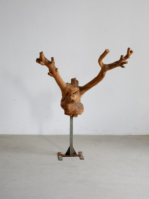Sculptural wood figure This piece was found in an old artist atelier north of Stockholm, featuring a carved finish and attatched to a metal base. Dimentions: 110 x 90 x 55