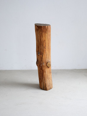 Sculptural wood pedestal This piece was found in an old artist atelier north of Stockholm, with newspaper scrap details and a sanded finish. Dimentions: 106 x 22 x 24