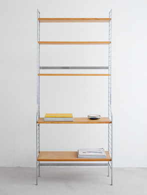 Nisse Strinning Continental bookshelf. Stainless steel and teak. Made in Sweden during the 1960s, produced by String design.  Dimentions: 73 x 31 x 12