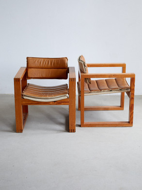Ate van Apeldoorn armchair This cubic armchair made of solid pine. Was designed by Ate van Apeldoorn in the 1970s. Features a stitched seat and backrest made of cognac colord leather. Dimentions 62 x 56 x 66