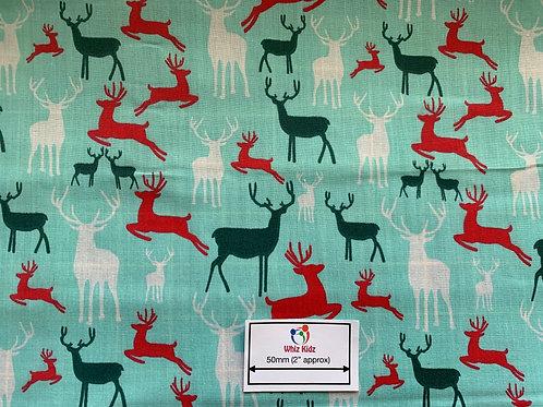 1331 Multi Reindeer on Aqua Polycotton