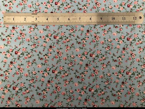 1117 Pink flower on blue background polycotton