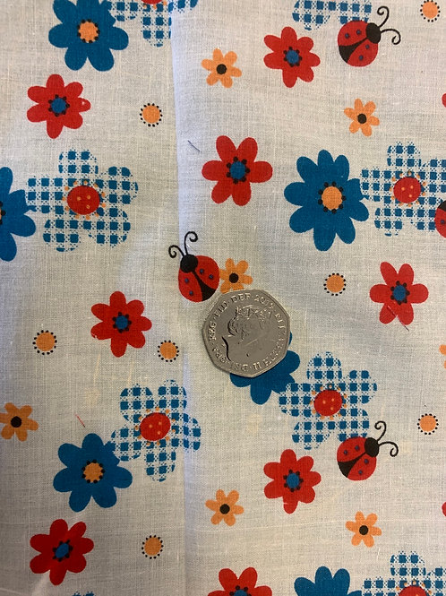 1133 Ladybird with Turquoise flower