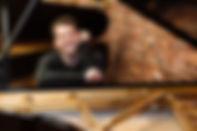 henry-at-piano.jpeg