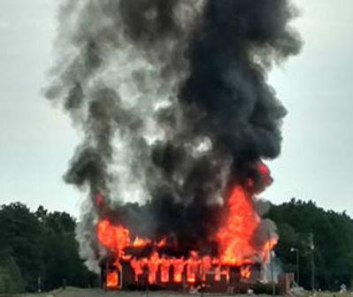 A church engulfed in flames