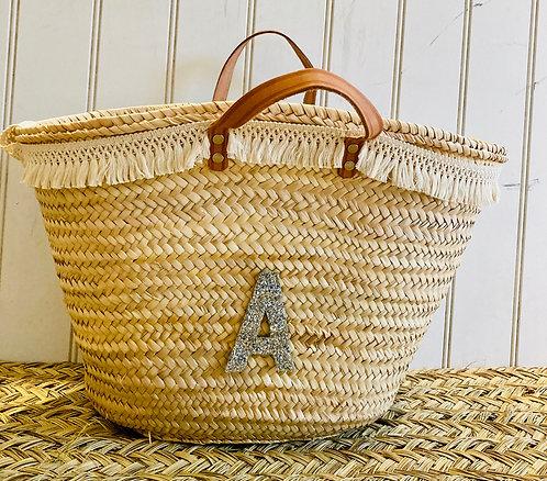 Macrame trimmed basket