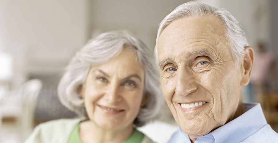 Senior smiling with denture