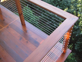 Steel wire deck handrail look great. Topped with a deckboard for an attractive matching finish.
