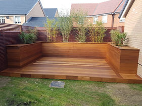 Hardwood deck and surrounding deck planters in Basildon. Built using Balau hardwood decking