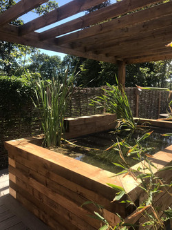 Koi pond from sleepers