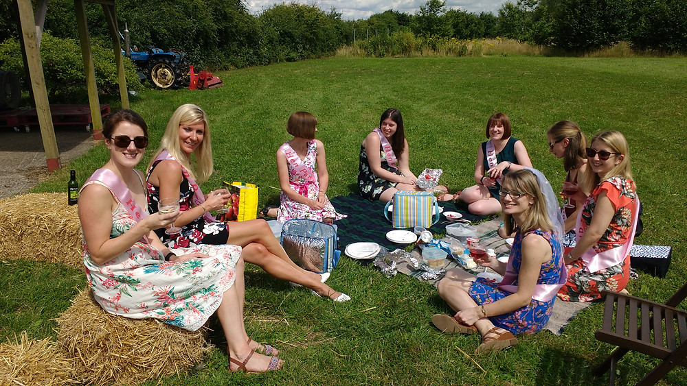 Hen party enjoying a vineyard picnic