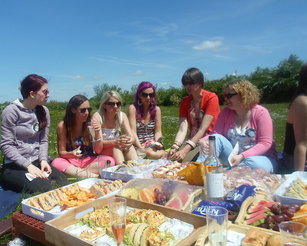 Hen party enjoying vineyard picnic