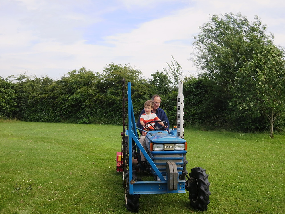 Child sitting on tractor