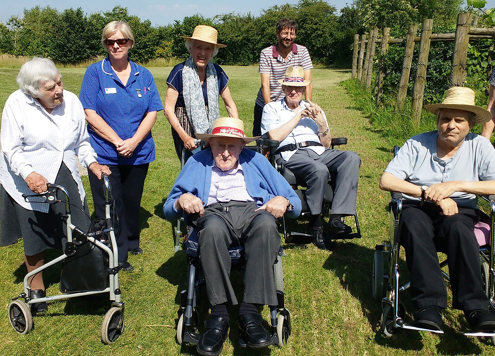Wheelchair users tour the vineyard