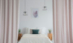 pink-curtains-in-bright-bedroom-PKGDBUW.