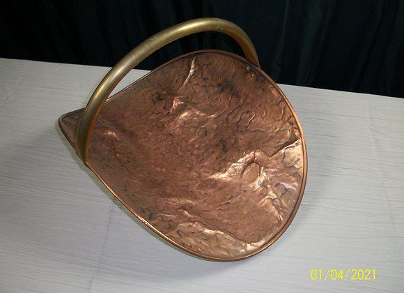 Porte bois en cuivre