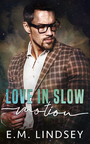 a man looking down wearing glasses and a brown plaid jacket.  Text reads Love In Slow Motion by E.M. Lindsey