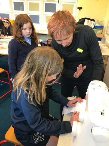 We introduced Sewing Machines to the class and assisted them with putting together their project!