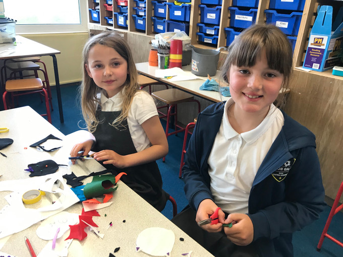 Carefully pinning and hand-sewing their creations!